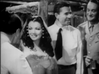 I wish I had a better screen cap from Sundown (1941). That's Gene Tierney second from left and George Sanders on the far right.