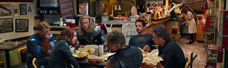 The Avengers, exhausted from saving the world, eat shawarma in a bombed-out diner.