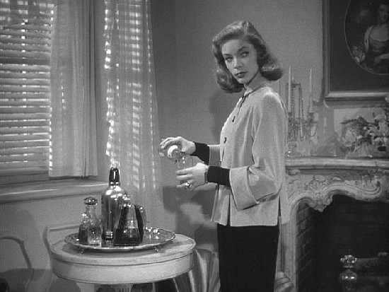 """I sat down...and looked at Mrs. Regan. She was worth a stare. She was trouble."" Lauren Bacall as Vivian"