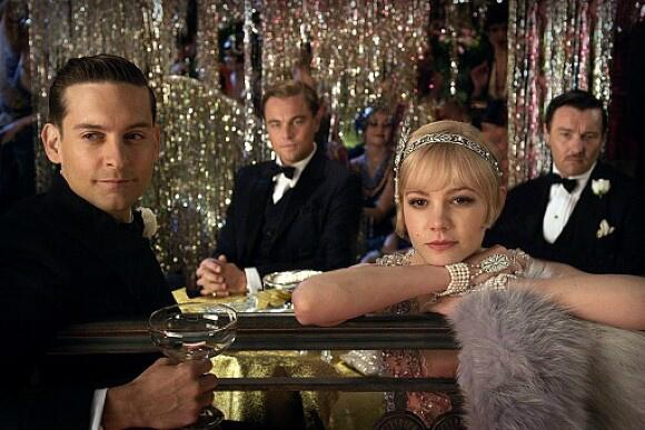 """The party has begun..."" GATSBY (2013): Tobey Maguire, Leonardo DiCaprio, Carey Mulligan and Joel Edgerton"