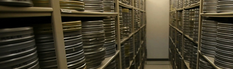 many many film reels stacked on shelves