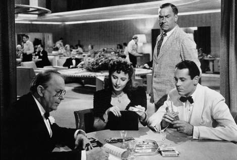 Charles Coburn and Stanwyck work their magic on Henry Fonda under William Demarest's watchful eye  in THE LADY EVE