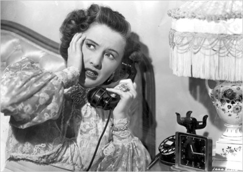 Stanwyck gets an earful of details of a murder...her own?