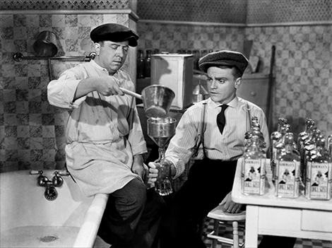 Frank McHugh and James Cagney bottle a little fun in THE ROARING TWENTIES (1939).