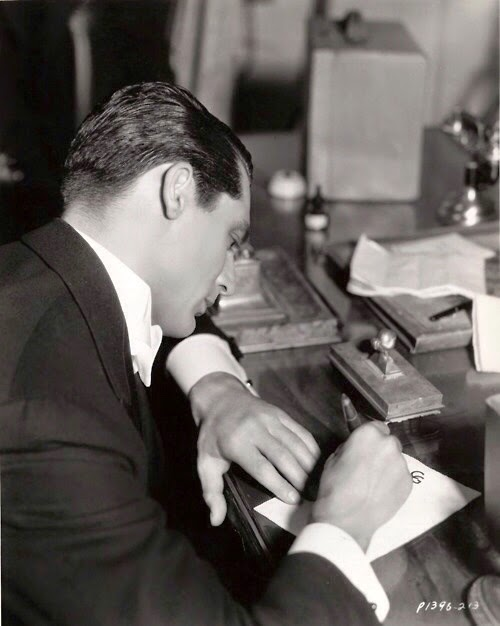 Cary Grant writing a letter